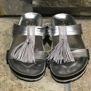 New, American Eagle, silver slides with tassels.